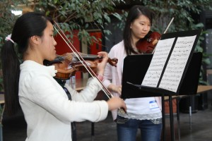 Associate Instructors practice a piece to play for the other students.